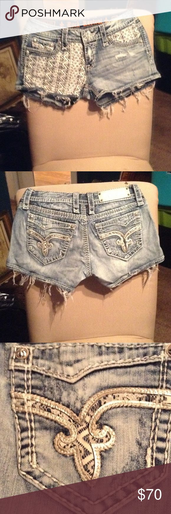 NEW ROCK REVIVAL SHORTS FROM THE BUCKLE ADORABLE THESE WERE WORE ONCE WASHED AND PUT AWAY SO THEY ARE LIKE NEW EXCELLENT CONDITION THEY ARE DISTRESSED WITH ADORABLE WHITE LACE ENLAY ON THE POCKETS AND ON THE FRONT THEY ARE THE VIVIAN STYLE AND ARE A BUCKLE EXCLUSIVE Rock Revival Shorts Skorts