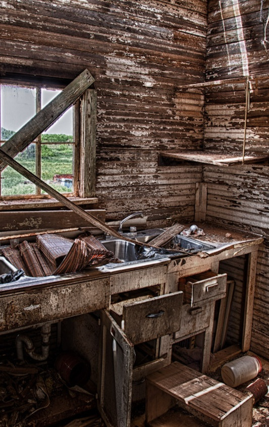 Abandoned Kitchen Of Old Farm House... it's not even that old; look at the sink fixture- 80s? Amazing how fast things can decay.