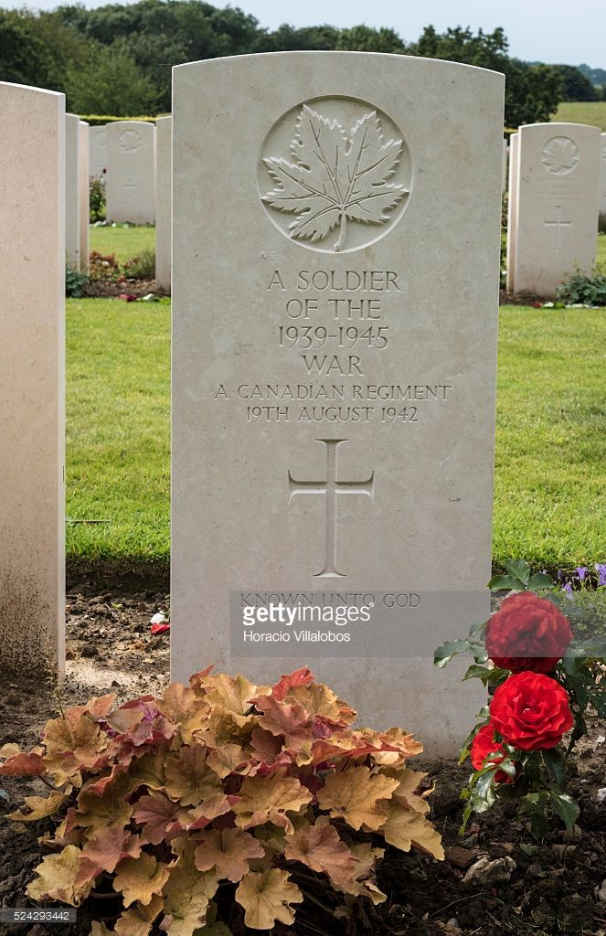 Grave of an unknown soldier seen at Canadian War Cemetery near Dieppe, France, 19 August 2013, on the 73rd anniversary of the Dieppe raid. More than 6000 allied troops, mostly Canadians, landed on 19 August 1942. At the end of the day, after a fierce battle, the Allies had 1550 dead and some 2400 prisoners. 948 Commonwealth servicemen of WWII are buried or commemorated in this cemetery.