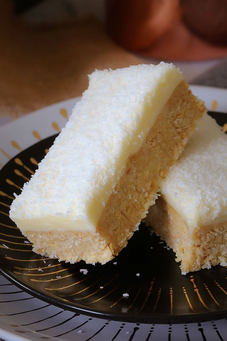 The BEST EVER LEMON & COCONUT SLICE is absolutely perfect! A beautiful tangy base topped with a creamy lemon frosting… it seriously doesn't get any better than this! #lemon #coconut #slice #bars #nobake #recipe #best #easy #thermomix #conventional #lunchbox #classic