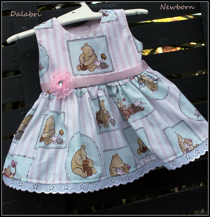 A beautiful little classic pooh bear dress  with a bit of bling added.