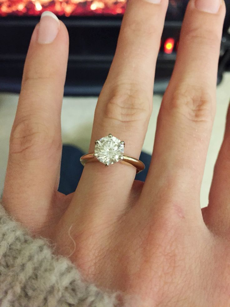 My engagement ring! It's just too perfect. Can't stop staring! #solitare #rounddiamond #goldband