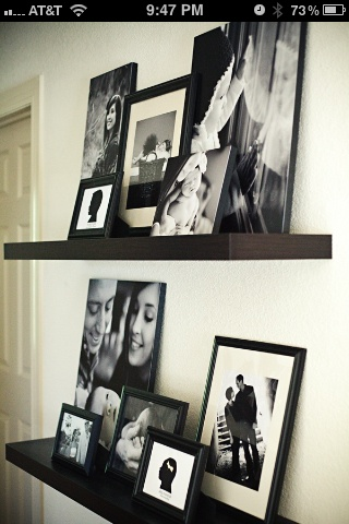 Black and white photos on floating shelves