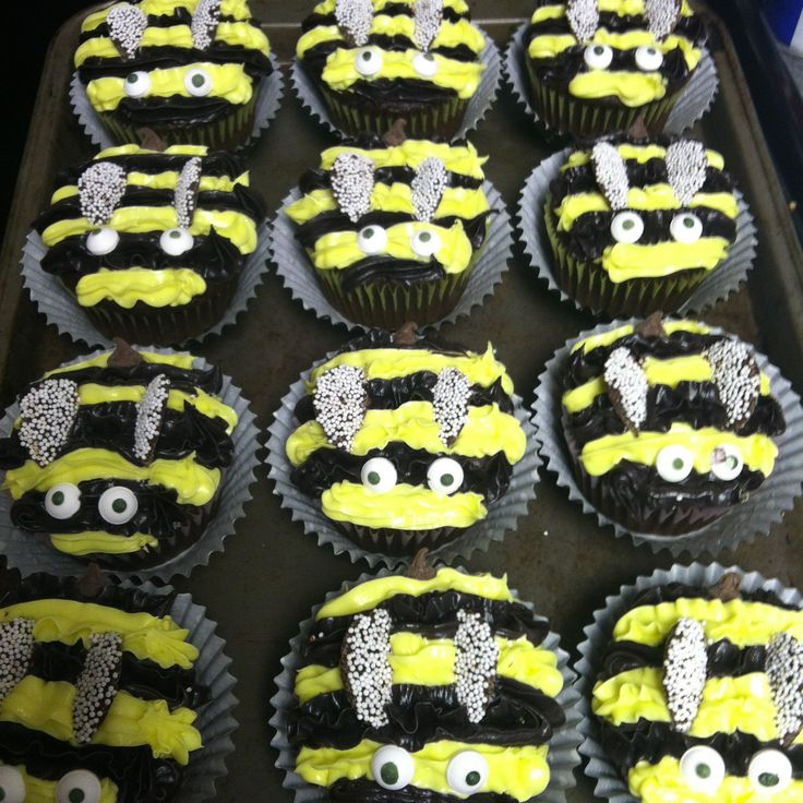 Bumblebee cupcakes- I made these for Rachel's bumble bee birthday party. I used chocolate nonpareils cut in half for the wings, spray cans of frosting to do the stripes, chocolate chips for the stingers, and bought the eyes at a cake supply store. They were surprisingly easy to make! #bumblebee #cupcakes