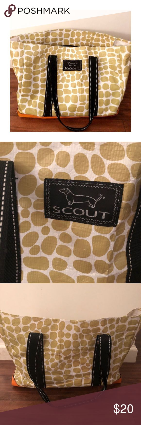 {SCOUT BAGS} Original Deano in Gold Giraffe Print All-weather woven fabric has all the qualities necessary for those who put function first. Measures 19-inches wide by 15-inches high by 10-inches deep Strap drop measures 8-1/4-inches long This tote is ideal for carrying pretty much everything Folds flat for easy storage Interior key ring; Sturdy faux leather base It's lightweight, durable, water resistant, and easy to clean; Hose or wipe clean, with or without soap — it's just that simple…