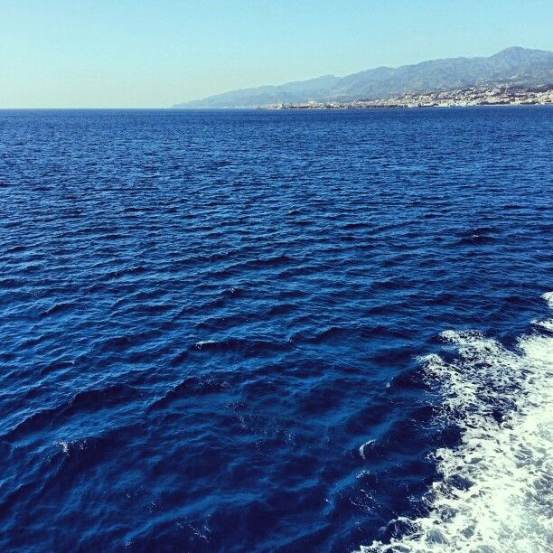 in the middle of the sea between Reggio Calabria and Messina