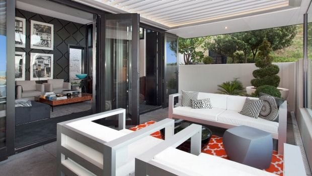 During rebuilding the owners reworked the house's outdoor spaces to make the most of sun and shelter.