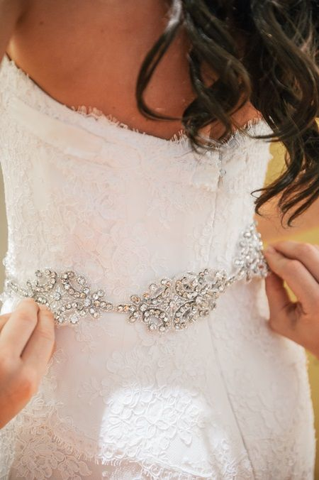 A crystal belt added understated sparkle to this @Mandy Dewey Seasons Resort Maui bride's waistline.