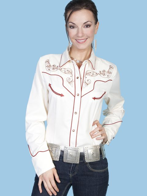 Cream Scully Blouse embroidered in Heart and Wings design in a rusty red color matches the piping and smily pockets.  Very soft and fresh looking to be worn with any western wear items.  Add a western hat and western boots to complete the look.  The embroidered back looks as pretty as the front.  The front and cuffs close with snaps.  Poly/Rayon.  Machine wash cold.  Hang to Dry.
