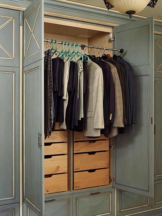 Movable clothing rods inside your wardrobe unit provide easy access to clothes while choosing outfits. The metal rod can be pushed up to keep clothes out of the way, or pulled down to shoulder height for more convenience. Built-in drawers hidden behind wardrobe doors also help with closet organization./