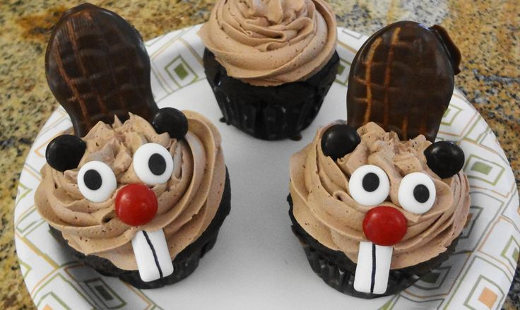Beaver cupcakes with chocolate dipped nutter butter cookies as tails