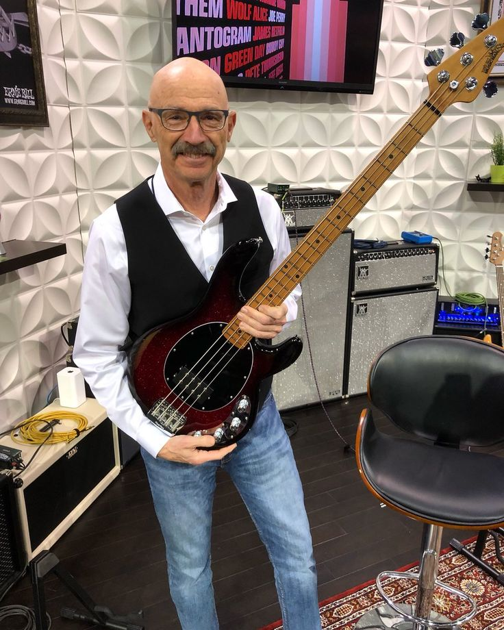 The great Tony Levin holding the new lightweight Music Man Stingray series