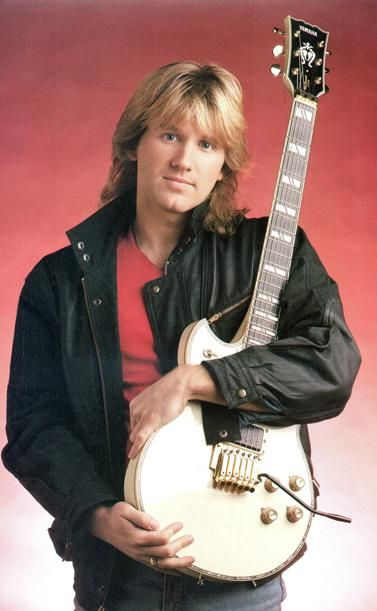 Rik Emmett - Canadian guitarist in the band Triumph. Although he is best known as a premier rock guitarist, his playing style incorporates rock, blues, jazz, classical, bluegrass and flamenco techniques. Similarly, his songwriting and discography demonstrate his ability to employ and blend multiple genres.