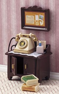 An adorable old fashion telephone desk.