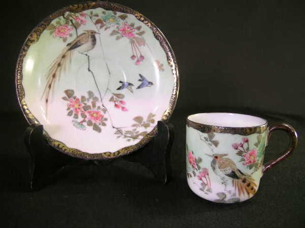 Lot 555: LIMOGES ASIAN FLORAL BIRD CUP SAUCER ANTIQUE - Chips under rim of saucer. Saucer measures 5` wide and cp is 3` wide x 2` high.