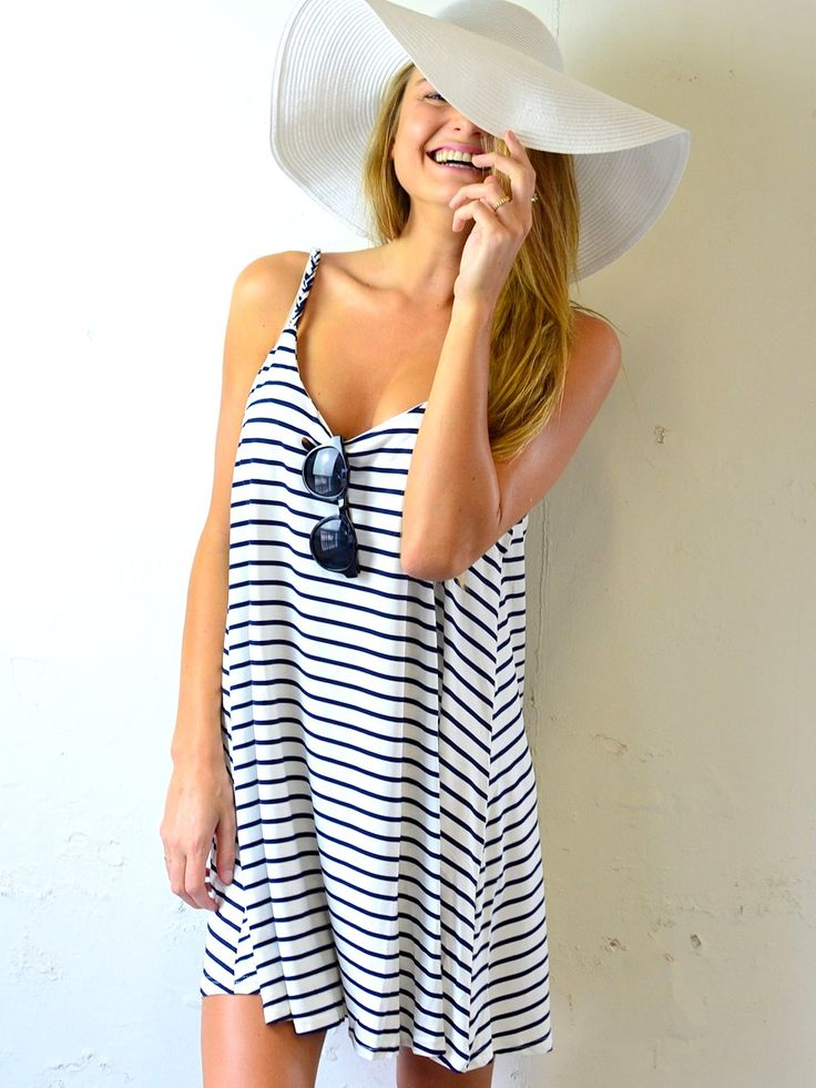 A loose swing dress makes for the perfect beach coverup. Just add a floppy hat, your go-to shades and lots of sun.