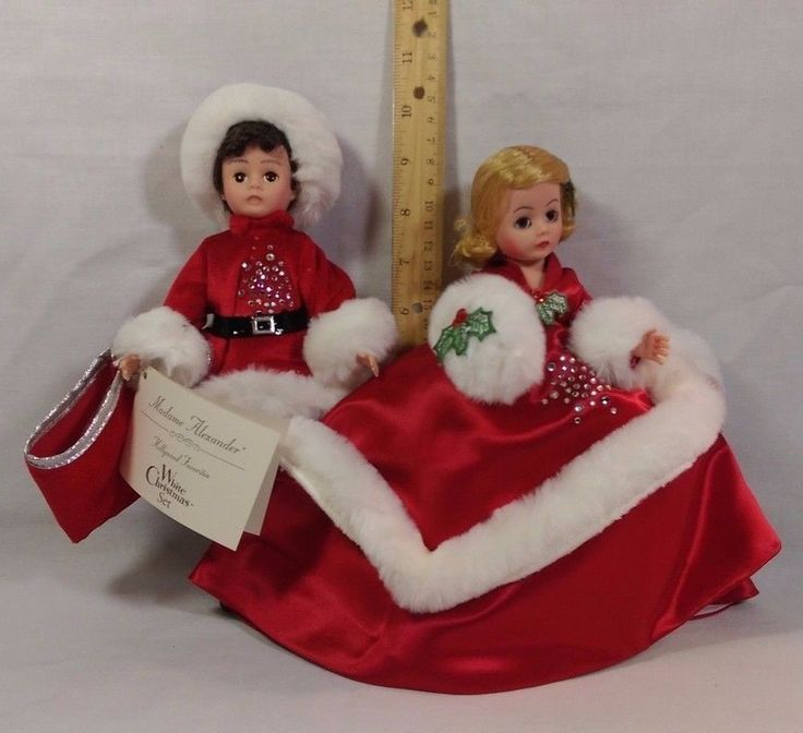 "This is for a set of two 8"" dolls by Madame Alexander. They are item #15380. They are the White Christmas set, part of the Hollywood Favorites collection. They were released in 1997. They are in mint condition and come with the original box. There are some presents that go in the boys bag. The presents are still in the original plastic pouch. There is also a pipe in the original plastic pouch. They come from a smoke free environment. 