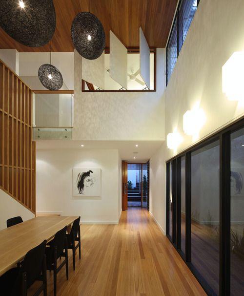 kalka home - Wilden street. Voluminous void space. Feature pendant lighting. Blackbutt timber flooring and feature ceiling. Internal casement windows. Small lot home, Brisbane. Shaun Lockyer Architects Design