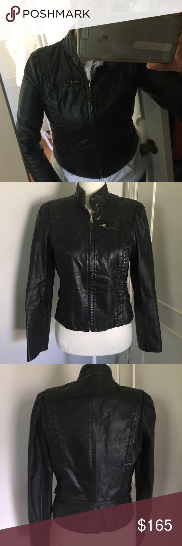 Vintage 80's cafe racer leather jacket Vintage 1980's tight fitted genuine leather cafe racer jacket. So Joan Jett!! Has adjustable sides and puffy shoulders. Vintage condition is good but shows wear. Fully lined. Fits small- medium. Also, I used to wear this going out in the 90's so it faintly smells like smoke. It's been 20 years, so it's not that bad, but just want full disclosure. Otherwise this is a non-smoking household. :) would look great paired with ankle boots or a pair of…