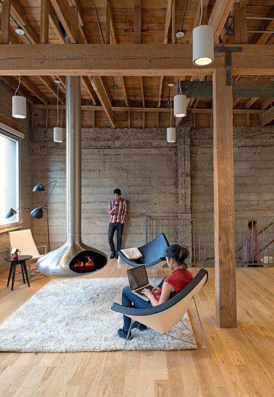 Hearth and Home: Why Architects Are Warming Once Again to the Age-old Hearth. Bruke (rund?) matte midt på for å samle rommet - motvirke møbleringen langs veggene.