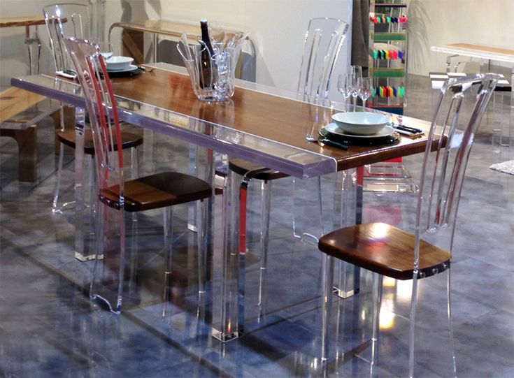 Cast acrylic and wood match together to create our dining table 'Stripes' and chairs 'Costantinopoli', from our new line Plexilos