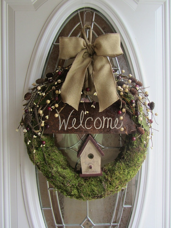 moss wreath, berry sprigs, bird house, welcome sign, burlap bow