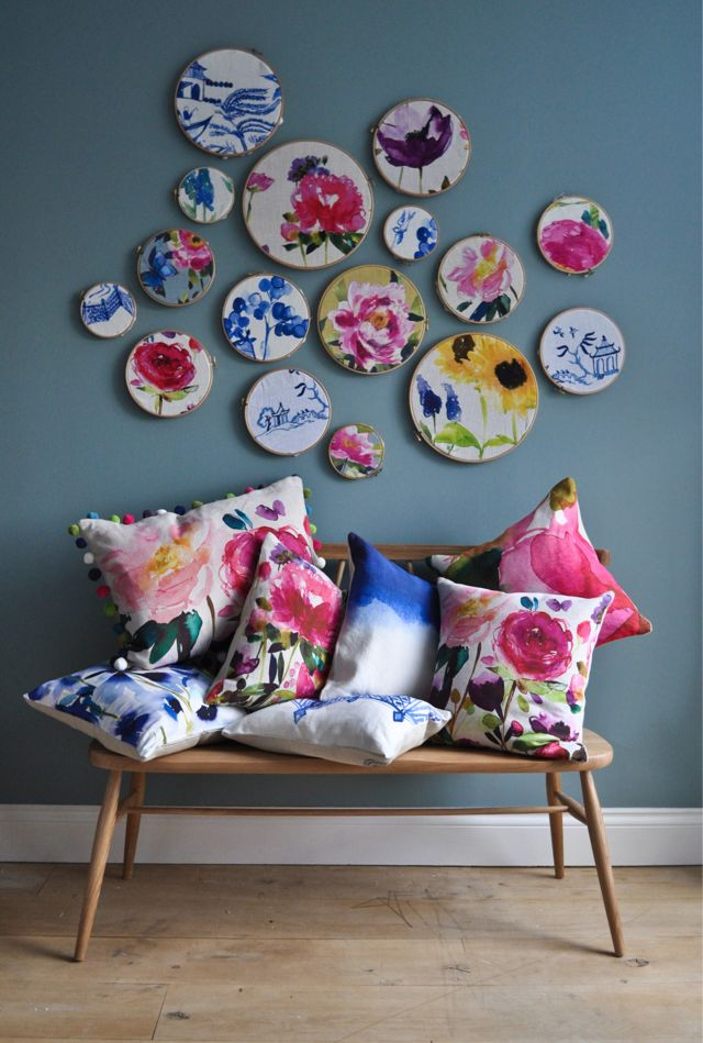 Colourful fabric in embroidery hoops. Fabric available from James Dunlop Textiles