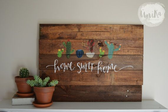 This old pallet has been cut, sanded, and stained into a brand new and beautiful life! Wire has been mounted onto the back for easy hanging.