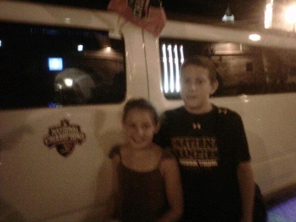 Manie and Luke standing by limo their Dad rode in for annual Gene Chizik Fantasy Football camp weekend.  Auburn June 2012