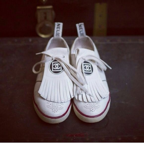 CHANEL white  tennis shoes  spectacular ✨ CHANEL tennis shoes  authentic Get this spectacular tennis shoes  it comes with the box and dust bag. Front part with fringes could easily be removed and reversible the  size is 40.5. But it fits a 39.5 CHANEL Shoes Athletic Shoes