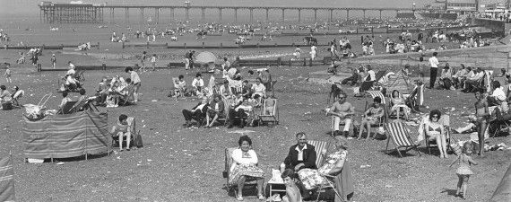 Hunstanton holidaymakers on the beach with the pier in the background on August 18, 1966. The pier was destroyed by storms 12 years after this picture was taken.