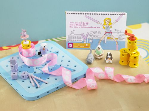 GoldiBlox.  Engineering toys for girls aged 5 - 9.  Basically Tinkertoys with a storybook. (Found on Kickstarter)
