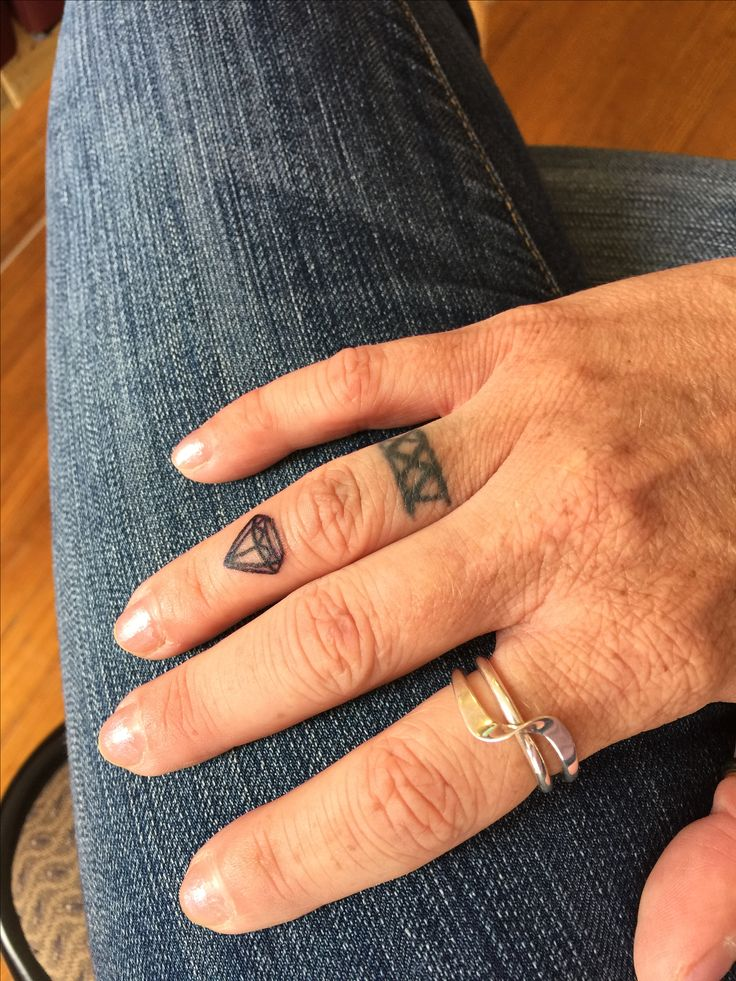 Diamond finger tattoo and XXV 25th Wedding Anniversary band tattoo