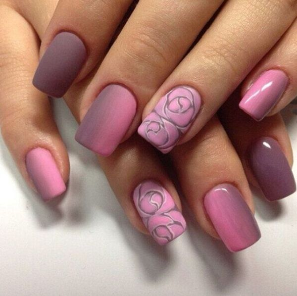 Beautiful old rose nail art design. The nails are painted in old rose color with gradient effects of old rose and violet polish. The roses look like they are engraved on the nails which makes it look even more interesting.