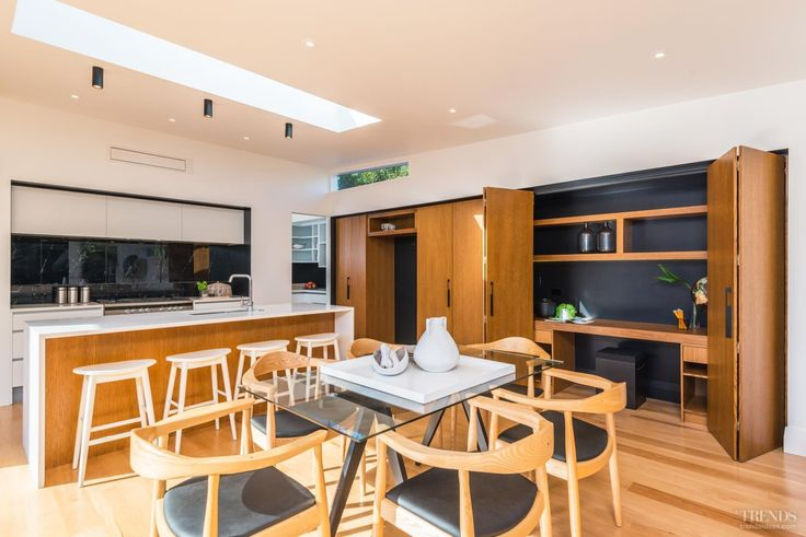 Modern kitchen boasts furniture like cabinetry and two tone scheme