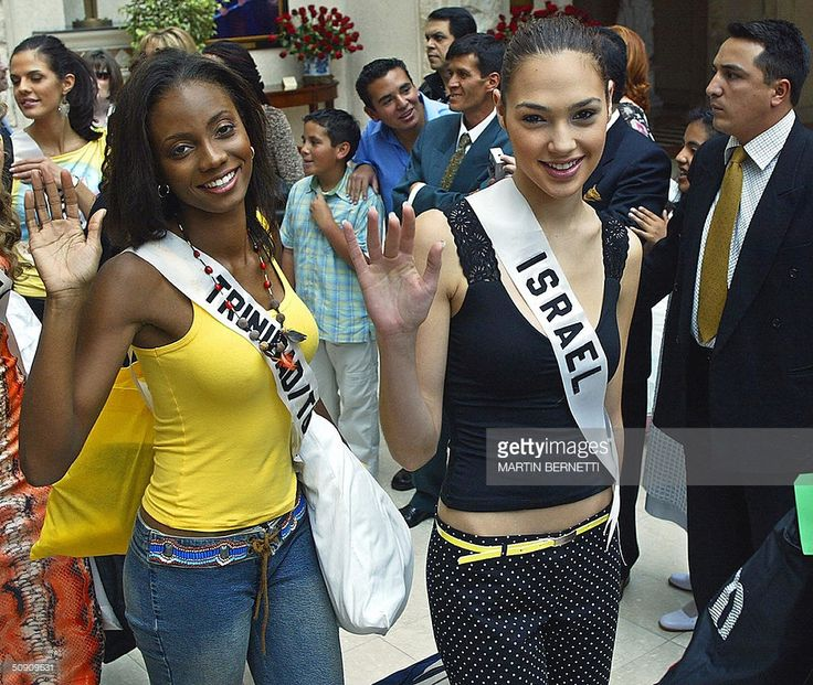 Miss Trinidad and Tobago Danielle Jones and Miss Israel Gal Gadot wave to photographers 29 May 2004, in Quito. The Miss Universe 2004 contest will take place next 01 June 2004. AFP PHOTO/Martin BERNETTI