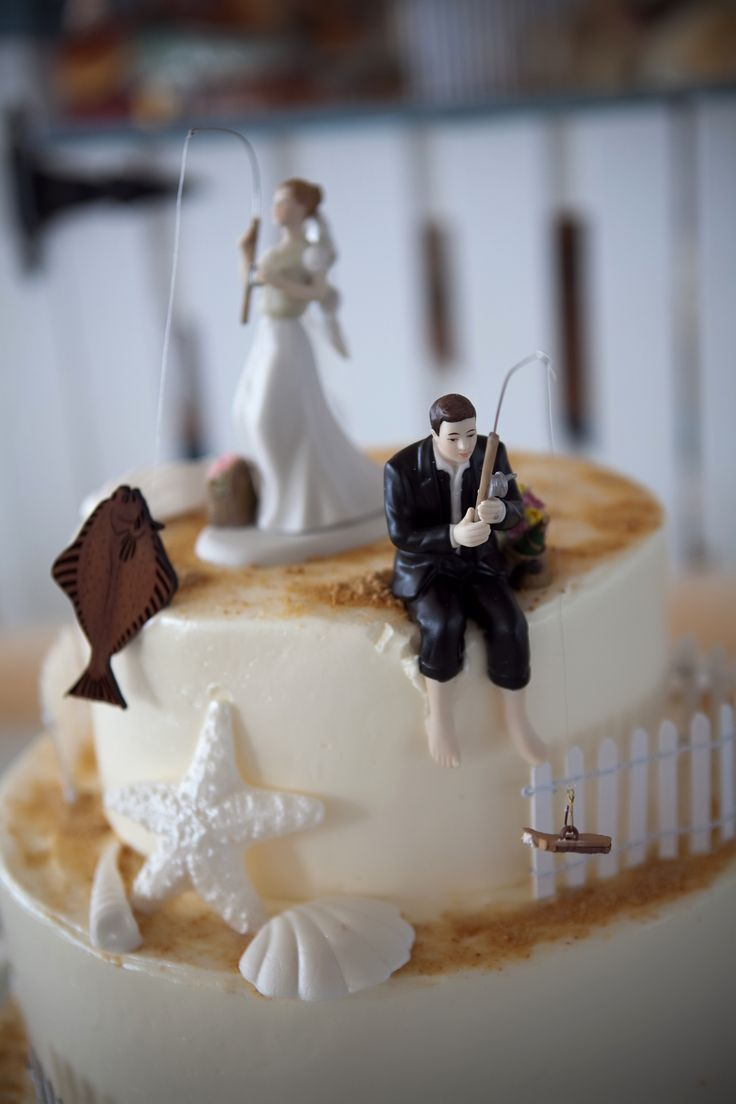Fishing Cake toppers from our wedding- bride with halibut and groom with boot