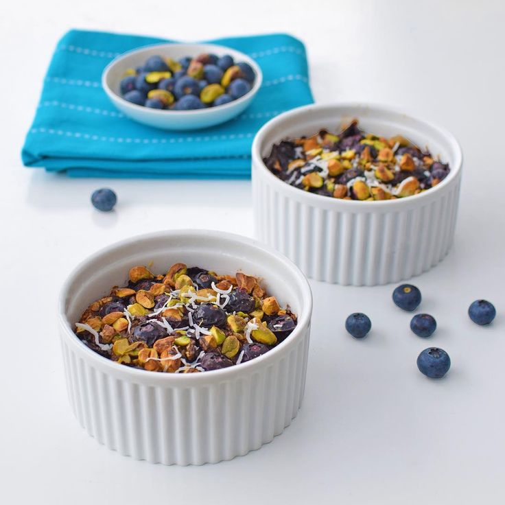 Here is a weekend breakfast for you! @missmarzipancom's Blueberry Muffin Baked Porridge Pots.  I made these earlier today to enjoy for breakfast tomorrow, but made the mistake of having a taste... And promptly polished one off for afternoon tea.  These delightful baked porridge pots are so easy to make and *actually* taste like a blueberry muffin, topped with pistachios, which add a lovely crunch. Recipe available at www.missmarzipan.com