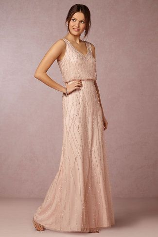 This full-length pink bridesmaid dress highlights one of the top colors for…