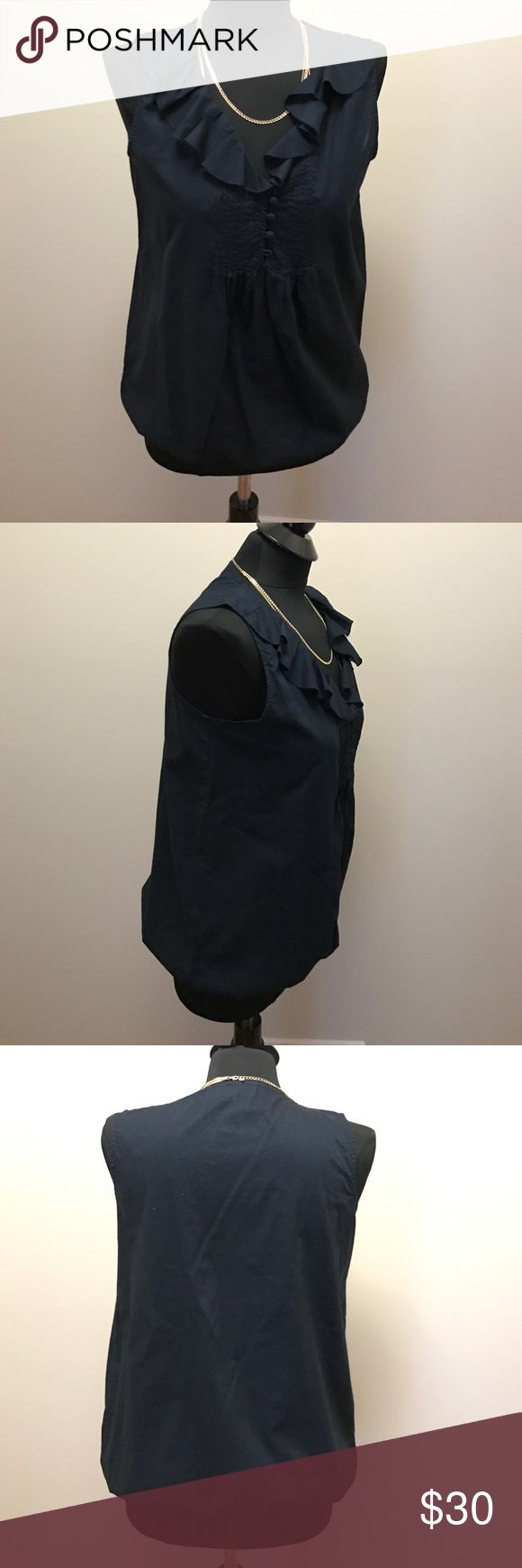 Ann Taylor LOFT Sleeveless Blouse Navy Blue Ann Taylor LOFT Sleeveless Blouse with ruffle detail and elastic waist. 100% Cotton. LOFT Tops Blouses
