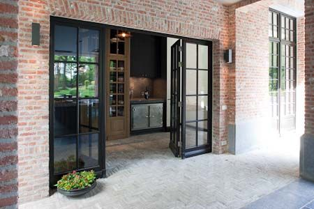Gorgeous kitchen with glass doors to patio for inside-outside living