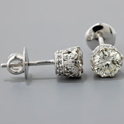 vintage diamond earrings.  I would love to have my diamonds set in mountings like this.