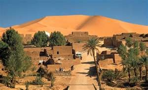 "Western Sahara, formerly called ""Spanish Sahara"".  This was a day trip we took from the Canary Islands.  Fascinating!  Had tea and roasted camel meat with a Bedouin tribe."
