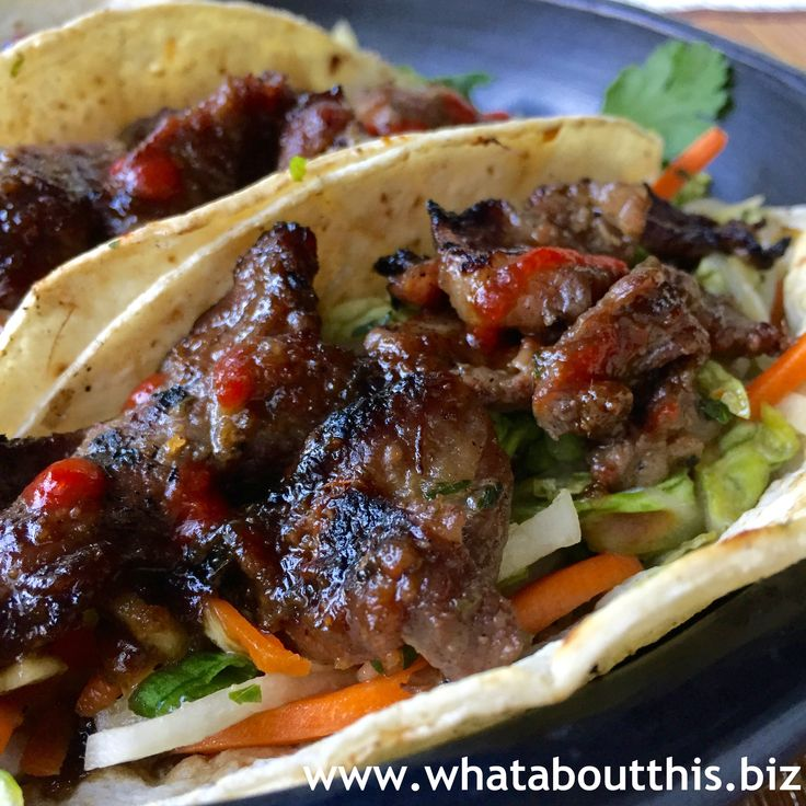 Tender pieces of grilled Korean bulgogi on top of a spicy slaw and wrapped in a soft corn tortilla, exemplify fusion cuisine. Sriracha sauce replaces taco sauce. Taking a favorite Mexican dish and …