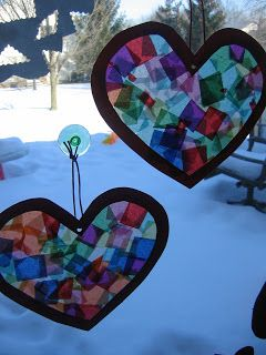 We made some heart sun catchers today using laminating sheets. You could also use contact paper, but I have found that these are a little ...