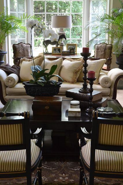 palm trees and orchid as decorative items for this colonial style lounge room