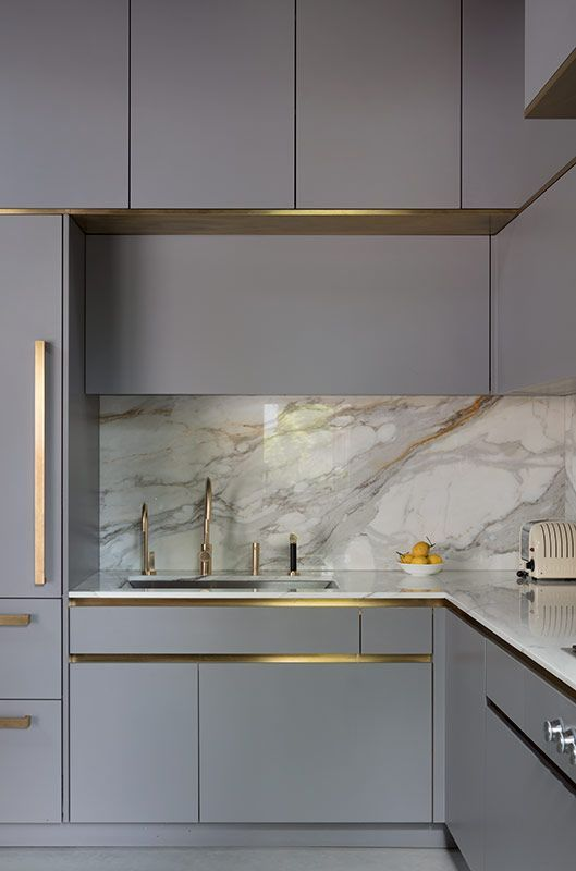 Govotsis: A matte lacquered kitchen with brass paneling from Roundhouse Design