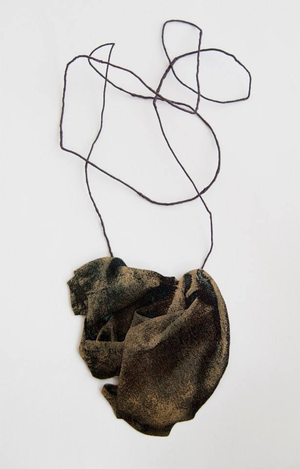 "Karin Gyllerfelt presents ""Brooches and necklaces"" Silver, textile thread - serie ""Imprint"""