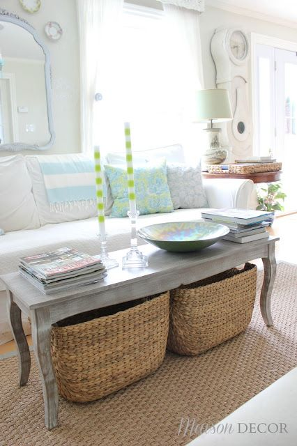 Style Tip! Switch it up by using a bench as a coffee table for a relaxed summer vibe.  Its a great place to stack books and hold a coffee cup or two.  Extra storage was gained underneath by adding two large woven baskets. This is a kid friendly option that doesn't sacrifice STYLE! Sponsored by HomeGoods