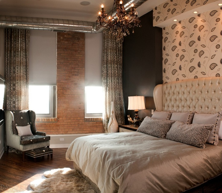 Interior of loft style bedroom in chicago designed by carrie ratliff